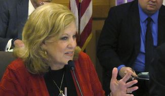 Kansas state Sen. Vicki Schmidt, R-Topeka, makes a comment during a Senate Ways and Means Committee discussion of budget proposals, Monday, March 20, 2017, at the Statehouse in Topeka, Kan. The committee is proposing a two percent pay increase for most state government workers. (AP Photo/John Hanna) **FILE**