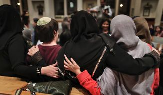 Members of the Sisterhood Salaam Shalom, gather for a group photo after a unity vigil held at the Jewish Theological Seminary in New York. The Sisterhood of Salaam Shalom, a national organization that brings together Muslim and Jewish women, organized the gathering as part of the organization's response to President Donald Trump's travel ban. (AP Photo/Julie Jacobson)