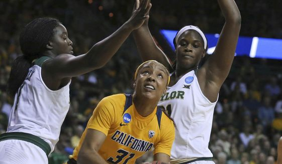 California forward Kristine Anigwe, center, is guarded by Baylor forward Dekeiya Cohen, left, and center Kalani Brown during the first half of a second-round game in the NCAA women's college basketball tournament in Waco, Texas, Monday, March 20, 2017. (AP Photo/Rod Aydelotte)