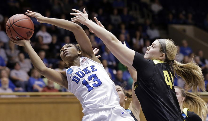 Duke's Crystal Primm (13) drives to the basket while Oregon's Mallory McGwire defends during the first half of a second-round game in the NCAA women's college basketball tournament in Durham, N.C., Monday, March 20, 2017. (AP Photo/Gerry Broome)