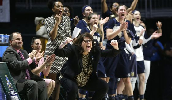 Quinnipiac head coach Tricia Fabbri, left, shouts during the first half of a second round game in the NCAA women's college basketball tournament against Miami, Monday, March 20, 2017, in Coral Gables, Fla. (AP Photo/Lynne Sladky)