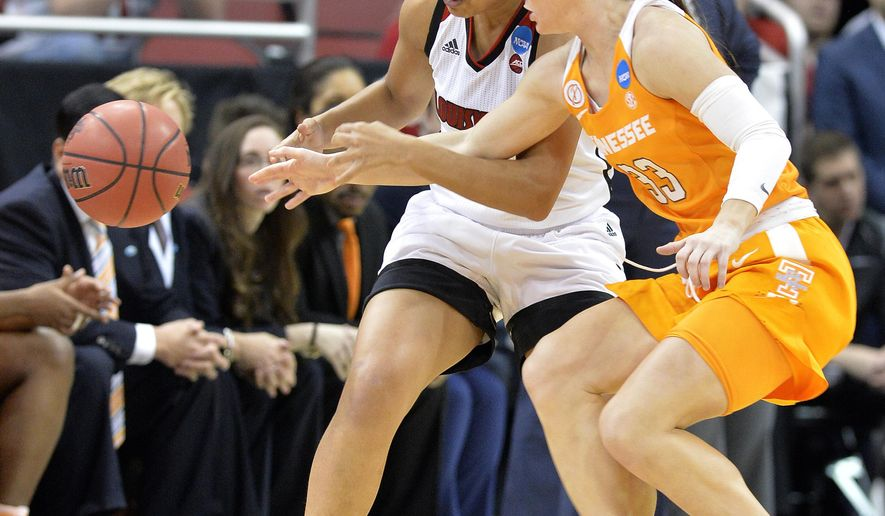 Tennessee's Alexa Middleton (33) tips the ball away from Louisville's Mariya Moore during the first half of a second-round game in the NCAA women's college basketball tournament, Monday, March. 20, 2017, in Louisville, Ky. (AP Photo/Timothy D. Easley)