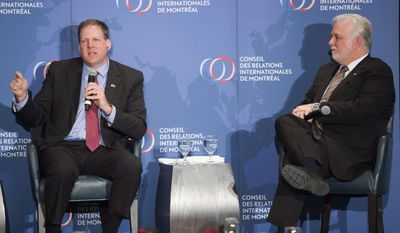 New Hampshire Gov. Chris Sununu, left, and Quebec Premier Philippe Couillard speak to the audience at a foreign relations luncheon, Monday, March 20, 2017 in Montreal. Sununu is in Quebec to discuss the economic relationship between the two and meet with business, political and community leaders.(Ryan Remiorz/The Canadian Press via AP)