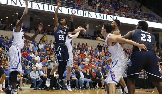 Akron guard Antino Jackson (55) drives in for a shot against Texas-Arlington in the first half of an NCAA college basketball game in the NIT, Monday, March 20, 2017, in Arlington, Texas. (Paul Moseley/Star-Telegram via AP)