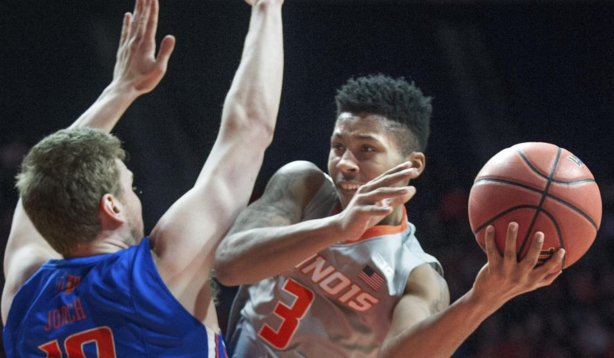 Illinois guard Te'Jon Lucas (3) passes around Boise State's center Robin Jorch (10) during an NCAA college basketball game in the NIT, in Champaign, Ill., Monday, March 20, 2017. (Robin Scholz/The News-Gazette via AP)