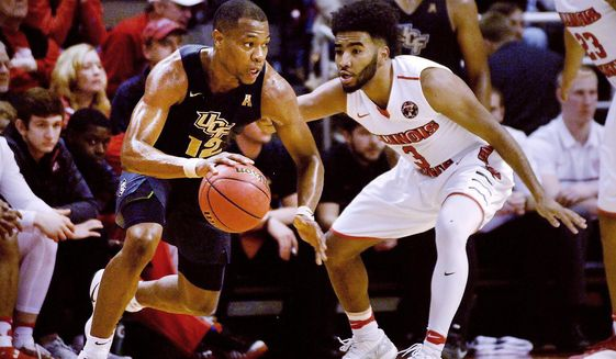 Central Florida guard Matt Williams (12) looks for an opening to the basket as Illinois State guard Keyshawn Evans (3) defends during an NCAA college basketball game in the NIT on Monday, March 20, 2017, at Redbird Arena in Normal, Ill. (David Proeber/The Pantagraph via AP)