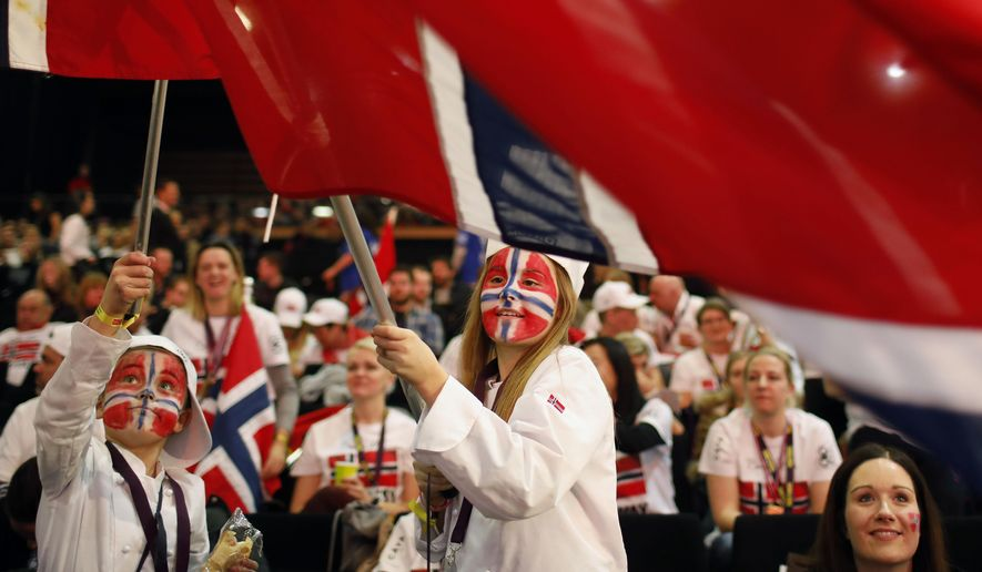 """Norwegian supporters wave their flags to support their Chef Christopher William Davidsen during the """"Bocuse d'Or"""" (Golden Bocuse) trophy, in Lyon, central France, Jan. 25, 2017. (AP Photo/Laurent Cipriani) ** FILE **"""