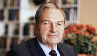 FILE - In this April 31, 1981, file photo, David Rockefeller poses for a photograph. The billionaire philanthropist who was the last of his generation in the famously philanthropic Rockefeller family died, Monday, March 20, 2017, according to a family spokesman. (AP Photo/D. Pickoff, File)