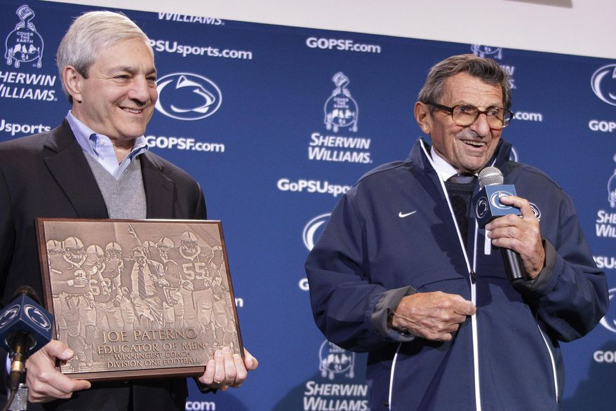 FILE – In this Oct. 29, 2011, file photo, Penn State President Graham Spanier, left, presents head football coach Joe Paterno, right, with a plaque commemorating Paterno's 409th collegiate win after an NCAA college football game against Illinois in State College, Pa. Jury selection is scheduled to begin in Harrisburg, Pa., on Monday, March 20, 2017, in Spanier's trial on charges that children were put at risk by how he responded to complaints about Penn State assistant football coach Jerry Sandusky more than 15 years ago. (AP Photo/Gene J. Puskar, File)