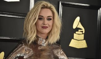 "FILE - In this Feb. 12, 2017, file photo, Katy Perry arrives at the 59th annual Grammy Awards at the Staples Center in Los Angeles. In an acceptance speech for an award at a Human Rights Campaign dinner on March 18, 2017, in Los Angeles, Perry said she ""prayed the gay away"" during her ""unconscious adolescence.""   (Photo by Jordan Strauss/Invision/AP, File)"