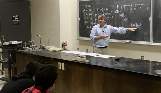 In this March 6, 2017 photo, University of Wisconsin-Madison chemistry professor Robert Hamers lectures during a class in Madison, Wis.  Wisconsin Gov. Scott Walker has joined a national conservative push to get professors to do more teaching and less research.  (AP Photo/Todd Richmond)