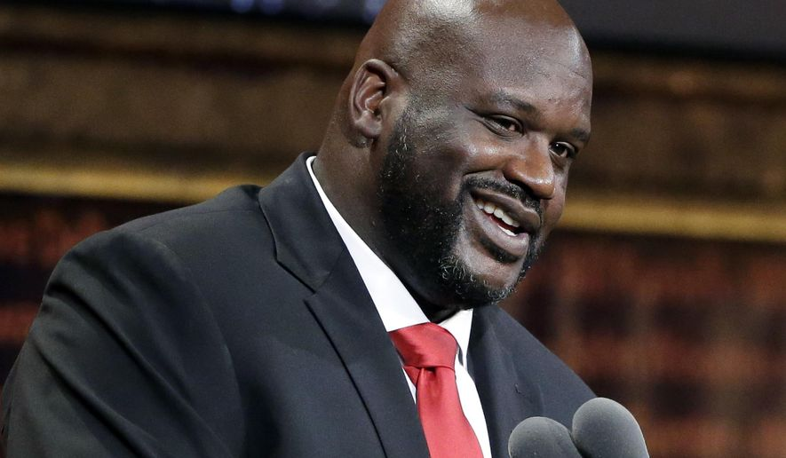FILE - In this Sept. 9, 2016, file photo, basketball Hall of Fame inductee Shaquille O'Neal speaks during induction ceremonies in Springfield, Mass. O'Neal said on the March 20, 2017, edition of his podcast that he believes the world is flat. (AP Photo/Elise Amendola, File)