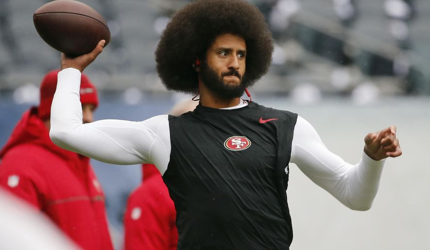 "San Francisco 49ers quarterback Colin Kaepernick warms up before an NFL football game against the Chicago Bears. Spike Lee said on Instagram Sunday, March 19, 2017, that it was ""fishy"" that Kaepernick, now a free agent, hadn't been signed."" (AP Photo/Charles Rex Arbogast, File)"