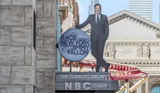 """This undated photo made available by Universal Orlando Resort, shows the new """"Race Through New York Starring Jimmy Fallon"""" ride in Orlando, Fla. Universal is leading the theme-park charge into """"virtual lines"""" that give visitors options for exploring a park or watching live entertainment instead of the tedium of looking at someone's back as you inch forward step by step to the thrill ride. (Universal Orlando Resort via AP)"""