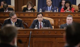 House Intelligence Committee member Rep. Joaquin Castro, D-Texas, center, flanked by Rep. Denny Heck, D-Wash., left, and Rep. Rick Crawford, R-Ark., questions FBI Director James B. Comey on Capitol Hill in Washington, Monday, March 20, 2017, during the committee's hearing on allegations of Russian interference in the 2016 U.S. presidential election. (AP Photo/J. Scott Applewhite) ** FILE **