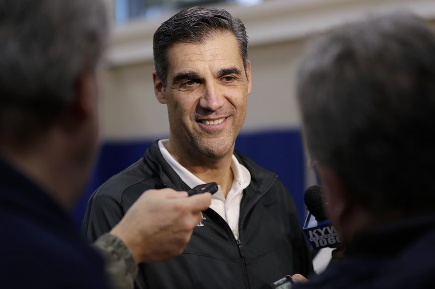 Villanova's Jay Wright smiles while listening to a question during a media availability at the NCAA college basketball team's practice facility, Monday, March 20, 2017, in Villanova, Pa. (AP Photo/Matt Slocum)