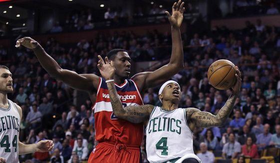 Boston Celtics guard Isaiah Thomas (4) drives to the basket against Washington Wizards center Ian Mahinmi (28) during the first quarter in Boston, Monday, March 20, 2017. (AP Photo/Charles Krupa)