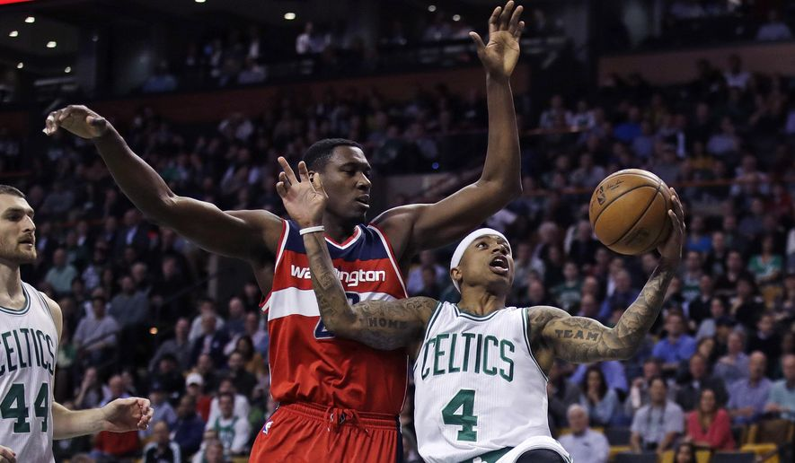 Boston Celtics guard Isaiah Thomas (4) drives to the basket against Washington Wizards center Ian Mahinmi (28) during the first quarter in Boston, Monday, March 20, 2017. (AP Photo/Charles Krupa)