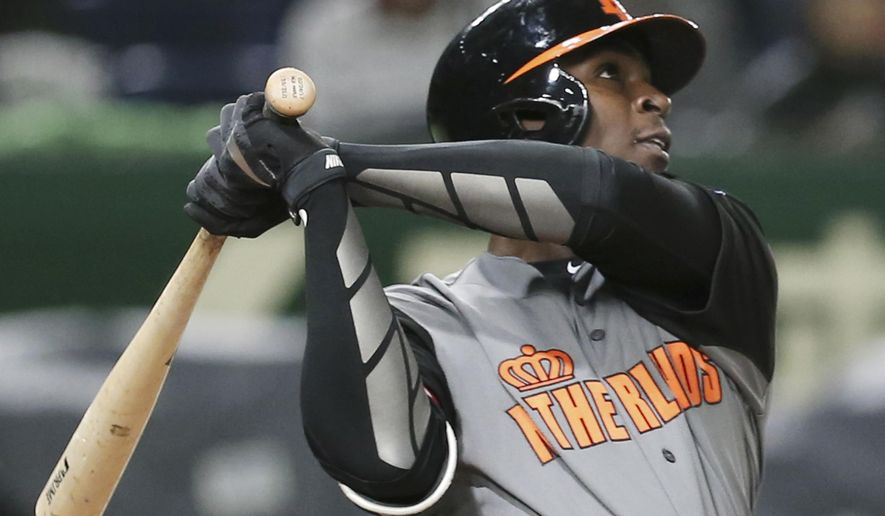 """FILE - In this March 13, 2017, file photo, Netherlands' designated hitter Didi Gregorius hits a three-run home-run off Israel's pitcher Danny Burawa during the fourth inning of their second round game at the World Baseball Classic at Tokyo Dome in Tokyo. New York Yankees shortstop Didi Gregorius has a bruised right shoulder, ending his time at the World Baseball Classic and leaving his status for opening day in doubt. Yankees manager Joe Girardi didn't put on a timetable on a return, only saying, """"He's going to be sidelined for a bit.""""(AP Photo/Koji Sasahara, File)"""