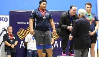 Laurel Hubbard of New Zealand (center) took gold in the women's over 90kg division at the Australian International. (Australian Weightlifting Federation)
