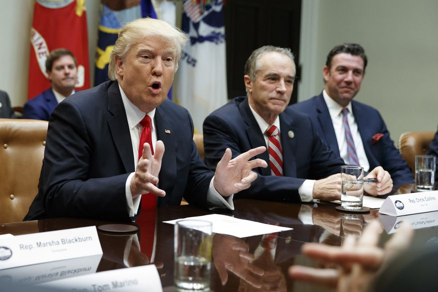 FILE - In this Feb. 16, 2017 file photo, President Donald Trump, accompanied by Rep. Chris Collins, R-N.Y., speaks in the Roosevelt Room of the White House in Washington. House Republican leaders want to shift more than $2 billion in Medicaid costs from upstate counties to the New York State government. The provision would help mostly Republican-controlled counties that have struggled to subsidize Medicaid payments for the poor. New York City wouldnt get the same relief.  (AP Photo/Evan Vucci, File)