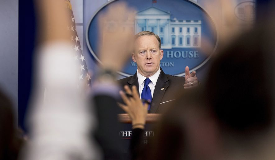 White House press secretary Sean Spicer takes a question from a member of the media during the daily press briefing at the White House in Washington, Tuesday, March 21, 2017. Spicer discussed healthcare, immigration, and other topics. (AP Photo/Andrew Harnik)