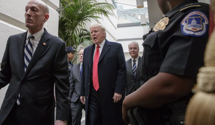 President Donald Trump, followed by Health and Human Services Secretary Tom Price, far right, leaves the Capitol after rallying support for the Republican health care overhaul with GOP lawmakers two days before the House plans a climactic vote that poses an important early test for his presidency, in Washington, Tuesday, March 21, 2017. (AP Photo/J. Scott Applewhite)