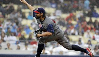 United States' Tanner Roark throws during the first inning of a semifinal in the World Baseball Classic against Japan in Los Angeles, Tuesday, March 21, 2017. (AP Photo/Chris Carlson)