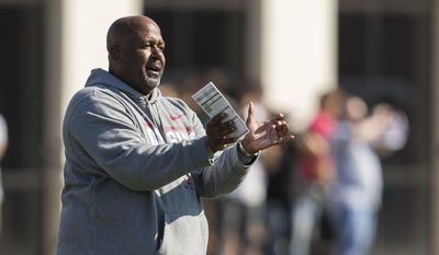 Alabama wide receivers coach Michael Locksley works with his players during a college football spring practice Tuesday, March 21, 2017, in Tuscaloosa, Ala. (Vasha Hunt/AL.com via AP)