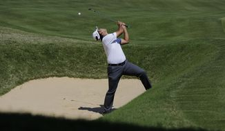Hideki Matsuyama, of Japan, watches his ball bounce back over him on the eighth hole as he practices for the Dell Technologies Match Play Championship golf tournament at Austin County Club, Tuesday, March 21, 2017, in Austin, Texas. (AP Photo/Eric Gay)