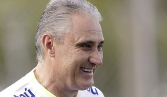 Brazil's coach Tite smiles during a training session of the national soccer team in Sao Paulo, Brazil, Monday, March 20, 2017. Brazil will face Uruguay in a 2018 World Cup qualifying soccer match on March 23. (AP Photo/Andre Penner)