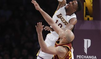 Los Angeles Lakers' David Nwaba, top, dunks over Cleveland Cavaliers' Richard Jefferson during the second half of an NBA basketball game Sunday, March 19, 2017, in Los Angeles. The Cavaliers won 125-120. (AP Photo/Jae C. Hong)