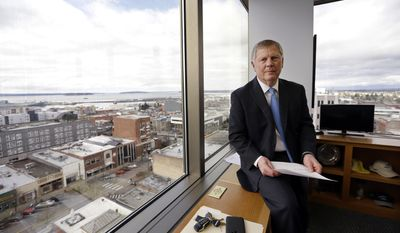 FILE--In this Feb. 16, 2017, file photo, Everett Mayor Ray Stephanson sits in his corner office overlooking downtown Everett, Wash. Stephanson is suing pharmaceutical giant Purdue Pharma, becoming the first city to try to hold the maker of OxyContin accountable for damages to his community. Connecticut-based Purdue Pharma argued in court documents filed Monday, March 20, 2017, there is no legal basis for such a lawsuit. (AP Photo/Elaine Thompson, file)