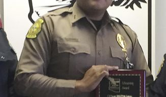 CORRECTS OFFICERS NAME TO HOUSTON JAMES LARGO, NOT JAMES LARGO. - FILE--This undated photo provided by the Navajo Nation Office of the President and Vice President, shows Navajo Nation police officer Houston James Largo. Largo died Sunday, March 12, 2017, after responding to a domestic violence call near the small town of Prewitt, N.M. Investigators say the man accused of killing Largo had spent the afternoon drinking and was intoxicated the night of the shooting. (Navajo Nation Office of the President and Vice President via AP, file)