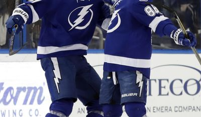Tampa Bay Lightning defenseman Victor Hedman (77) celebrates with right wing Nikita Kucherov (86) after Hedman scored against the Arizona Coyotes during the first period of an NHL hockey game Tuesday, March 21, 2017, in Tampa, Fla. (AP Photo/Chris O'Meara)