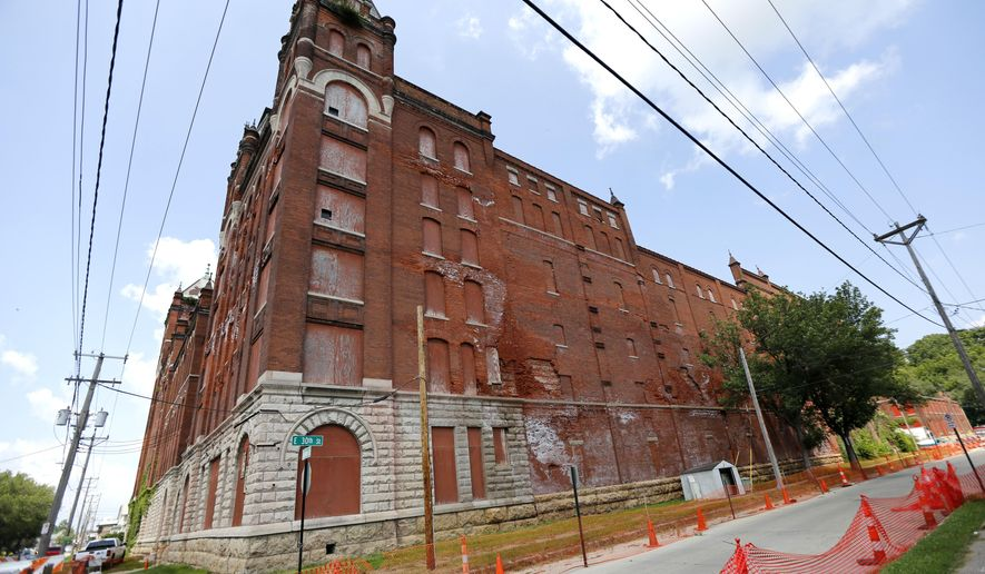 An Aug. 3, 2016 photo shows the H&W building at the corner of Jackson and E. 30th streets in Dubuque, Iowa. A Cedar Rapids developer has bought the historic, crumbling former brewery in Dubuque, offering hope of saving a landmark that once was among the largest brewers in the country. (Mike Burley/Telegraph Herald via AP)