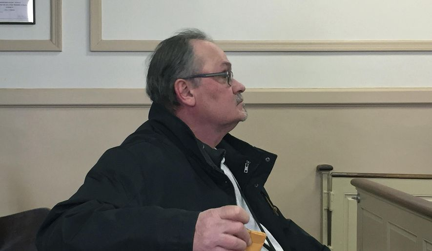 In this Monday, March 20, 2017 photo, Robert J. Guidi sits during a hearing where he pleaded guilty to theft by deception and violating New Jersey's Stolen Valor Act, at the Morris County Courthouse in Morristown, N.J. The Mine Hill, N.J., man, who served in a clerical position as a U.S. Army private during the Vietnam War, exaggerated his military record to get gifts including a nearly $32,000 deck. (Peggy Wright /The Daily Record via AP, Pool)