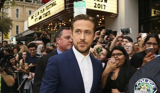 "FILE - In this March 10, 2017 file photo, actor Ryan Gosling arrives at the world premiere of his film, ""Song to Song"" during the South by Southwest Film Festival in Austin, Texas. The film, which also stars Michael Fassbender, Rooney Mara and Natalie Portman, was filmed in Austin. (Photo by Jack Plunkett/Invision/AP, File)"