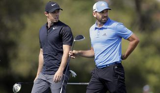 Rory McIlroy, of Northern Ireland, left, and Sergio Garcia, of Spain, walk off the 16th tee during a practice round for the Dell Match Play Championship golf tournament at Austin County Club, Tuesday, March 21, 2017, in Austin, Texas. (AP Photo/Eric Gay)Rory