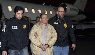 """FILE - In this Jan. 19, 2017 file photo provided U.S. law enforcement, authorities escort Joaquin """"El Chapo"""" Guzman, center, from a plane to a waiting caravan of SUVs at Long Island MacArthur Airport, in Ronkonkoma, N.Y. U.S. prosecutors and lawyers for infamous drug lord Guzman are sparring over his tough jail conditions. The government responded in court papers Tuesday, March 21, 2017, by saying the restrictions are appropriate for someone known for escaping twice from prison in Mexico. (U.S. law enforcement via AP, File)"""