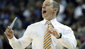 FILE - In this Feb. 18, 2017, file photo, Florida head coach Mike White calls out to his players in the second half of an NCAA college basketball game against Mississippi State in Starkville, Miss. White has the Gators two wins away from the Final Four. (AP Photo/Rogelio V. Solis, File)