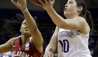 Washington's Kelsey Plum, right, drives past Oklahoma's Gioya Carter during the second half of a second-round game in the NCAA women's college basketball tournament Monday, March 20, 2017, in Seattle. Plum led all scorers with 38 points as Washington won 108-82. (AP Photo/Elaine Thompson)