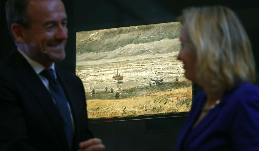 "Van Gogh Museum director Axel Rueger, left, and Jet Bussemaker, Minister for Education, Culture and Science, stand next to the stolen and recovered ""Seascape at Scheveningen"" by Dutch master Vincent van Gogh, during a press conference in Amsterdam, Netherlands, Tuesday, March 21, 2017. Two paintings by Vincent van Gogh titled ""Seascape at Scheveningen"" (1882) and ""Congregation leaving the Reformed Church in Nuenen,"" (1884-1885) returned to the Amsterdam museum after they were stolen from in a nighttime heist 15 years ago and recovered by Naples police in Italy. (AP Photo/Peter Dejong)"