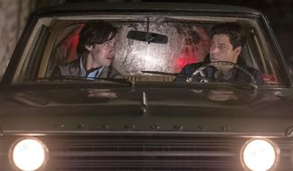 "In this image released by NBC, Milo Ventimiglia, left, and Jeremy Luke appear in a scene from ""This is Us.""  The heartwarming NBC series was second only to CBS' ""NCIS"" for the most popular show of the week for its debut season finale last week. The show reached 12.8 million viewers on the night it first aired, with the audience swelling to 16.9 million when people who watched via time delay over three days is added in, the Nielsen company said. (Ron Batzdorff/NBC via AP)"