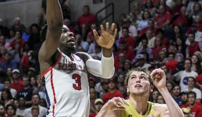 Mississippi guard Terence Davis (3) scores against Georgia Tech center Ben Lammers (44) during an NCAA college basketball game in the quarterfinals of the NIT on Tuesday, March 21, 2017, in Oxford, Miss. (Bruce Newman/The Oxford Eagle via AP)