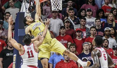 Georgia Tech guard Tadric Jackson (1) misses on a dunk attempt as Mississippi forward Sebastian Saiz (11) defends as Mississippi forward Marcanvis Hymon (5) looks on during an NCAA college basketball game in the quarterfinals of the NIT on Tuesday, March 21, 2017, in Oxford, Miss. (Bruce Newman/The Oxford Eagle via AP)