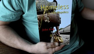 "ADVANCE FOR MONDAY MARCH 27 AND THEREAFTER - In a March 16, 2017 photo, John Fritz holds a copy of his book, ""Homeless is not Hopeless,"" at his apartment in St. Paul, Minn. Fritz rode the rails for nearly 25 years, always imagining he'd live and die as a self-described tramp. Alcoholism and troubling memories of childhood abuse were his downfall.   Fritz is the author of the self-published autobiography ""Homeless is Not Hopeless."" (Jean Pieri/Pioneer Press via AP)"