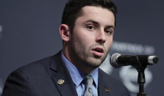 FILE- In this Dec. 10, 2016, file photo, Oklahoma's Baker Mayfield answers questions during a news conference before attending the Heisman Trophy award ceremony in New York. Mayfield will practice this spring as Oklahoma assesses the fallout from the star quarterback's arrest in Arkansas last month, coach Bob Stoops said Monday, March 20, 2017. (AP Photo/Julie Jacobson, File)