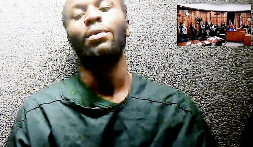 "Gerry Thomas, 28, appeared via video conference for his first appearance before Judge Joseph Perconti on Tuesday, March 21, 2017, in Paterson, N.J.  Two men pleaded not guilty Tuesday to murder charges stemming from a double homicide involving a burning car tied to a woman who often appears on ""Real Housewives of New Jersey."" Clarence Williams, and Thomas, entered their pleas during their initial court appearances made via a camera feed from the Passaic County jail. The mother of one of the victims yelled out, ""You're scum!"" when the men asked to conceal their faces so they could not be seen on the monitor and by news crews in the courtroom. (Amy Newman /The Record via AP)"