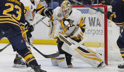 Buffalo Sabres Sam Reinhart (23) is stopped by Pittsburgh Penguins goalie Matthew Murray (30) during the first period of an NHL hockey game, Tuesday, March 21, 2017, in Buffalo, N.Y. (AP Photo/Jeffrey T. Barnes)